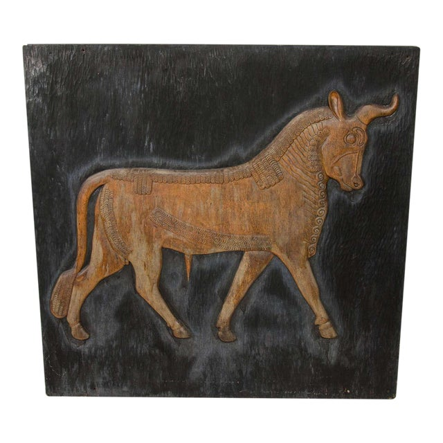 Rare artwork featuring Arabic bull in hand-carved reclaimed wood with exquisite attention to form and detail. Highly...