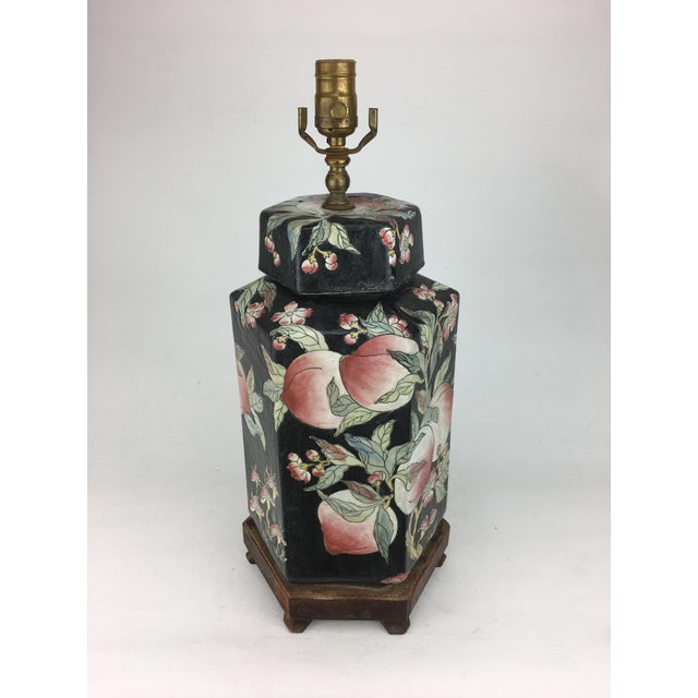 Enhance the appearance of any room quickly with this striking black vase lamp. This lamp features a porcelain vase...