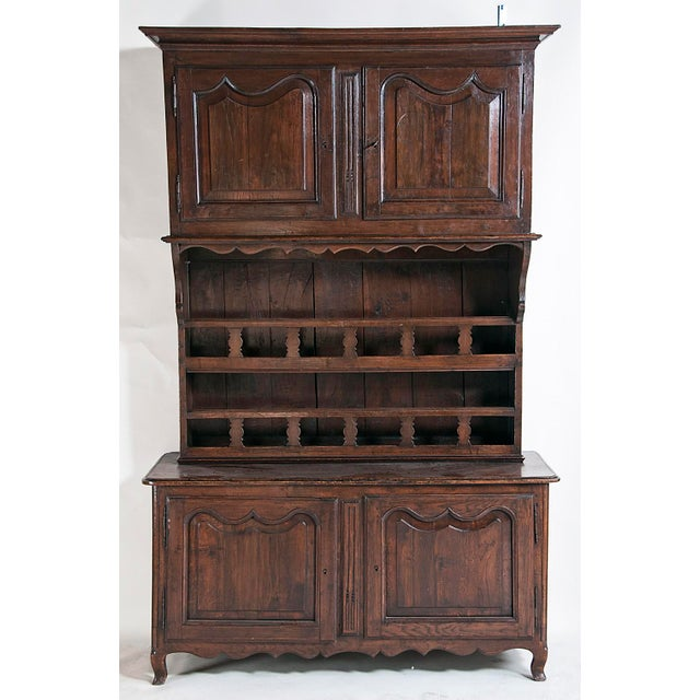 Unique kitchen cabinet dating from the late 19th century. Upper and lower storage with a plate or pewter rack in between....