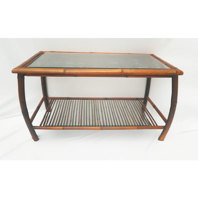 Vintage bamboo coffee table with 1/4 inch glass on both lower shelf and the top surface. Excellent condition, it has been...