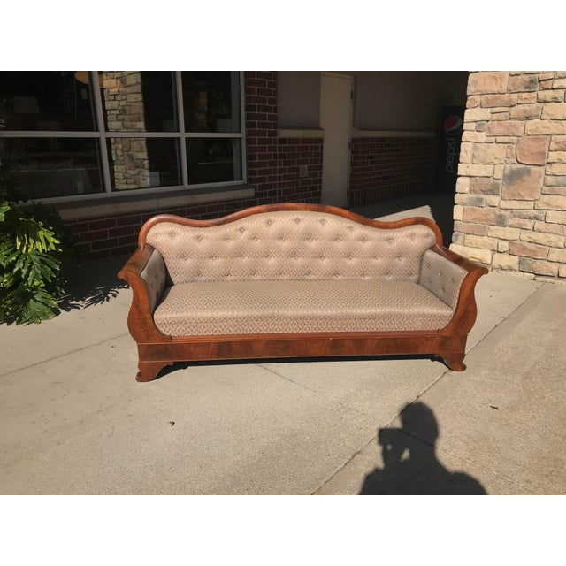 Graceful lines of this American empire sofa / settee displays Flame Mahogany veneer with very few issues to veneer....