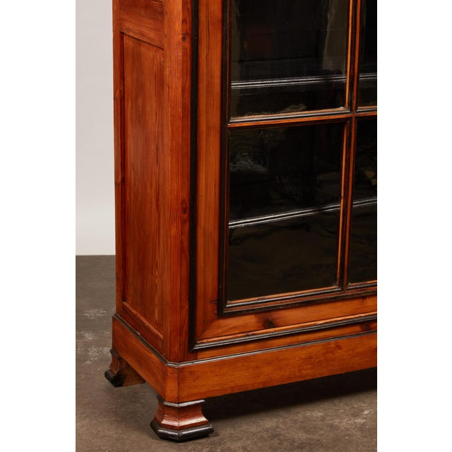 19th Century English pine cabinet with pair of large glass doors. Black painted interior and dark trim through front of...