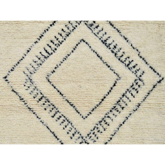 Moroccan Beni Ourain Runner handwoven with ivory and black wool in an abstract diamond pattern. Dimensions: 2'9 x 10'7