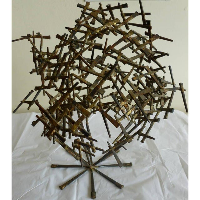 Cement nails put in random form make up this one of a kind vintage brutalist tabletop abstract sculpture. Some nails have...
