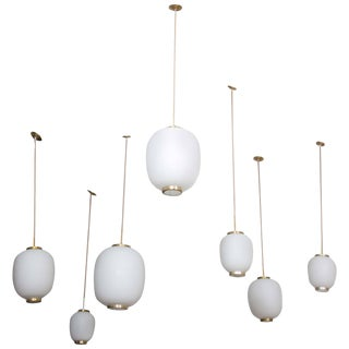 Collection of Eight Opaline Glass and Brass Ceiling Fixtures for Lyfa, 1950s For Sale