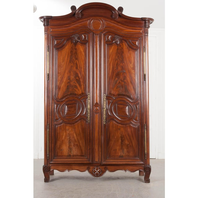 A gorgeous solid mahogany armoire, from the port of Normandy, France, circa 1780. This beautiful antique case piece was...