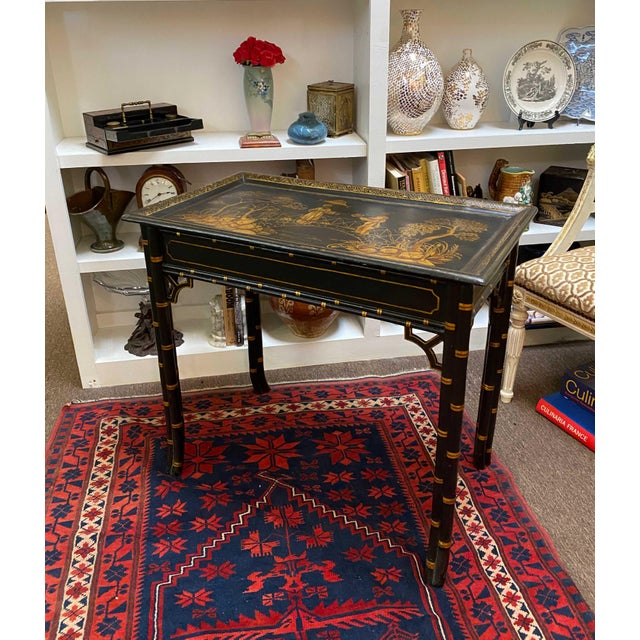 Early 20th century black lacquer and parcel gilt table from England. Provenance Nina Campbell, London