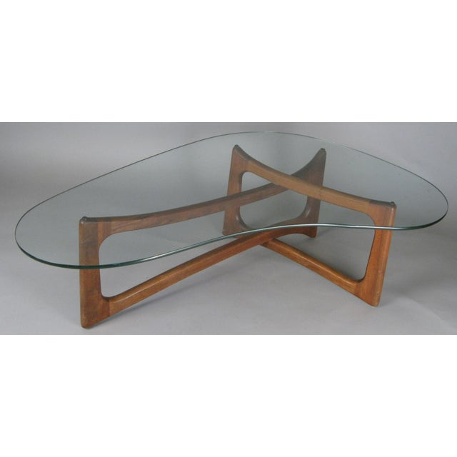 A beautiful 1960s modern asymmetric cocktail table designed by Adrian Pearsall for Craft Associates. the base with...