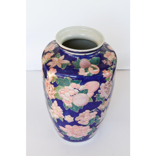 """Mid Century Beautiful Blue Ceramic Vase With Large Bouquets of Pink Flowers Outlined in Gold it measures 12"""" high, and 8""""..."""