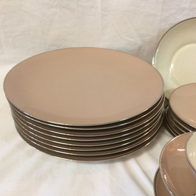 Partial set of Franciscan China in the Sandal Wood pattern. Made by Gladding McBean Brownish pink with silver rims and...