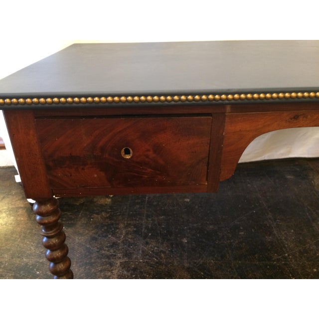This gorgeous, two-drawer desk with a newly refurbished leather top, complete with nailhead trim new gold castors make it...
