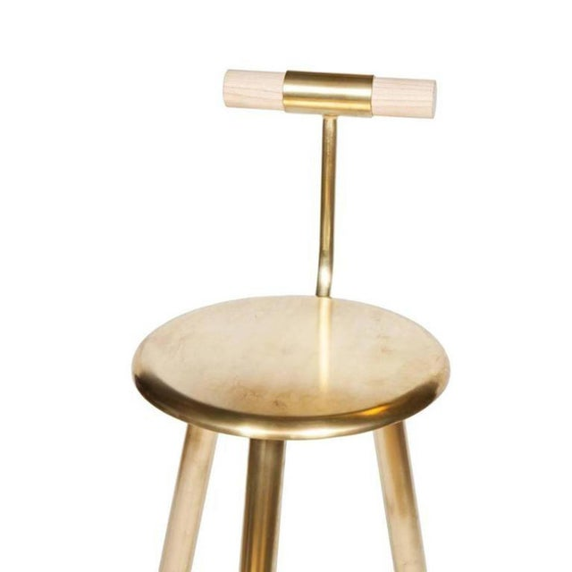 "Erickson Aesthetics hand polished brass tripod stool with oak backrest by Ben Erickson. Seat height 27"" Custom orders have..."