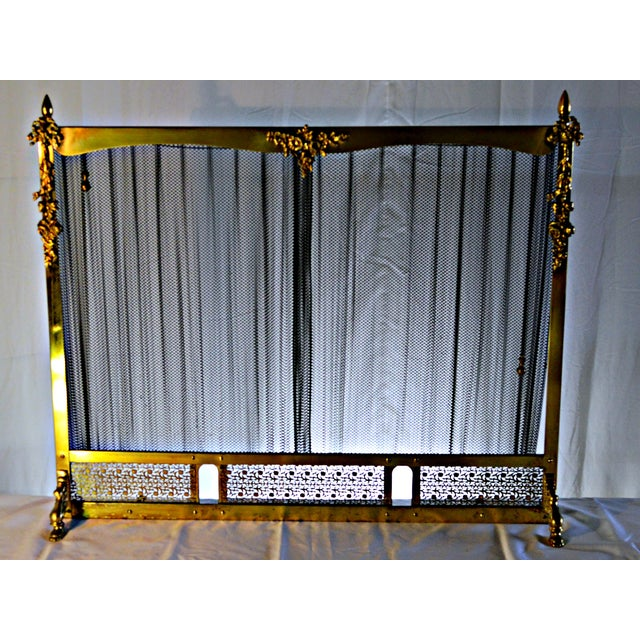 Offered is a stunning fireplace screen in very good working condition. The screen opens and closes smoothly by pulling the small chains on sides. B...