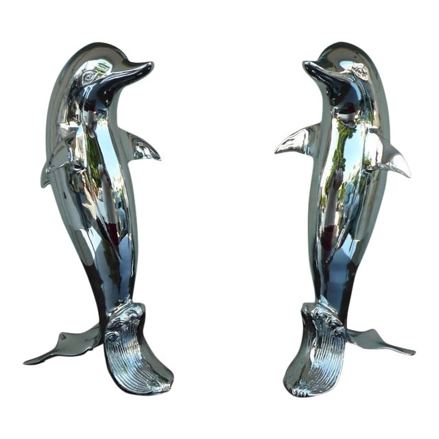 Pair of 70's Chromed Upright Swimming Dolphins For Sale