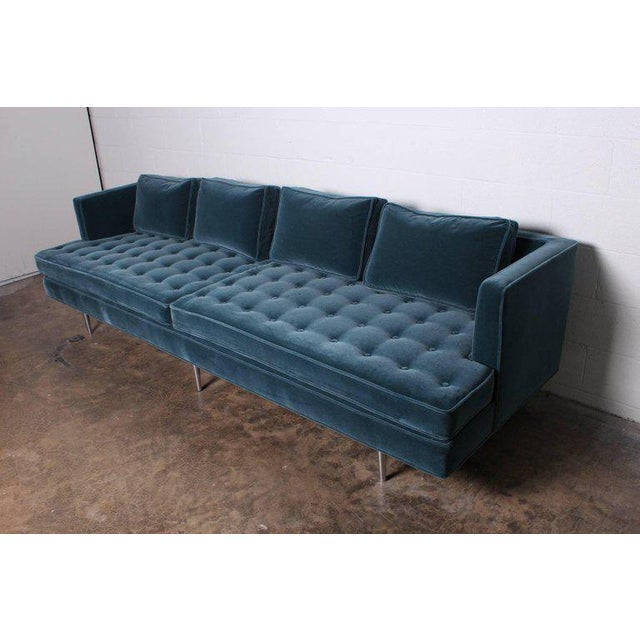 A Classic sofa design by Edward Wormley for Dunbar with polished nickel legs and fully restored in mohair upholstery with...