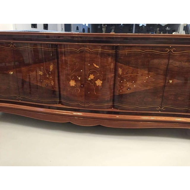 Gorgeous French Art Deco six-door buffet in the style of Jules Leleu. With beautiful Rosewood and mother-of-pearl inlay...