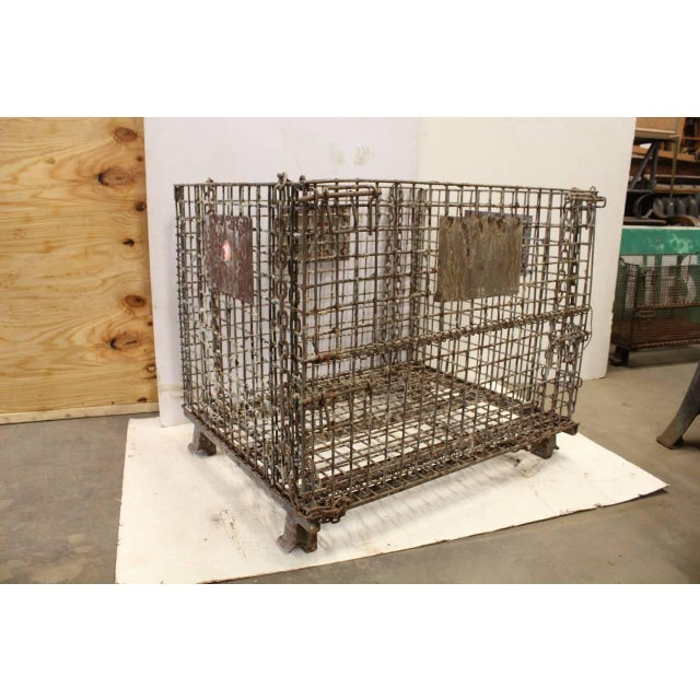 Giant antique American industrial collapsible basket. We have seven available.