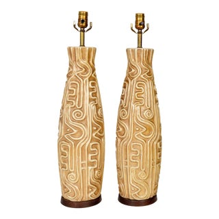 Tall Mid-Century High Relief Carved Tan Pottery Lamps - a Pair For Sale