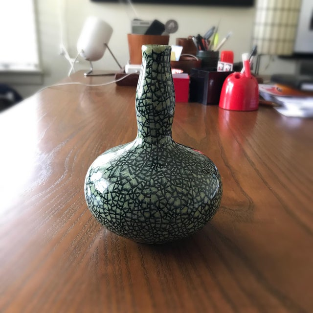 A beautifully glazed gourd vase from Pigeon Forge Pottery in Tennessee. The vase stands approximately 6 1/2 inches tall, 5...
