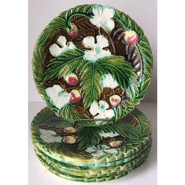 This absolutely spectacular set of 6 antique French Orchies Majolica plates feature strawberries, leaves and blossoms on a...