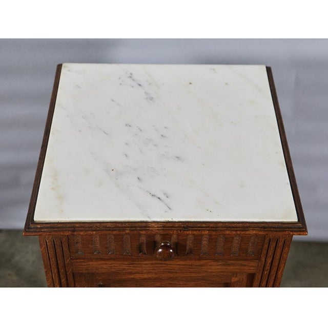 This handsome Henry II style Night Stand has a marble top and carved details throughout. The piece has one drawer, one...