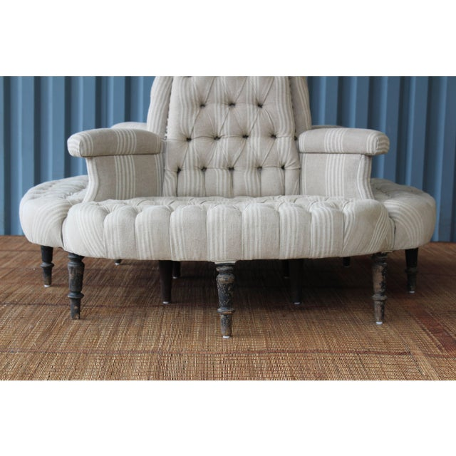 An antique 19th century Napoleon style boudoir sofa, perfect for a dressing room, retail space or foyer. This piece has...