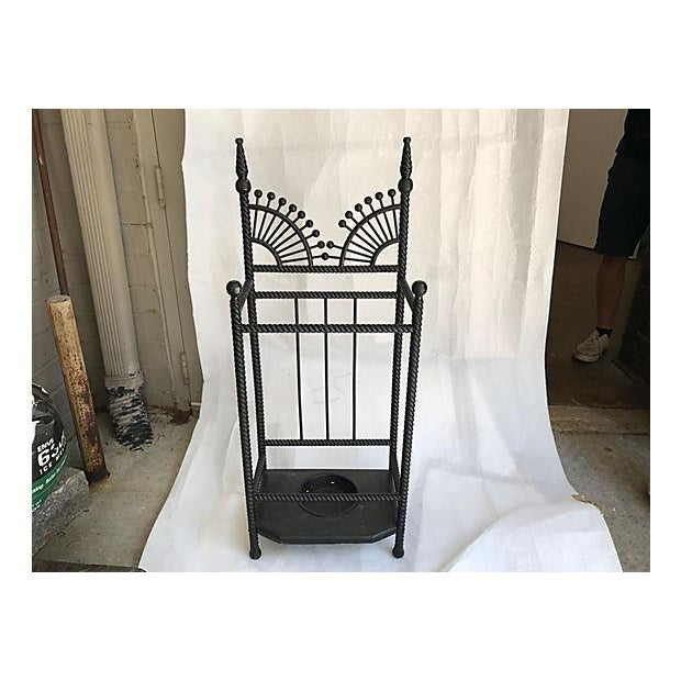 English painted turned wood umbrella stand with metal tray. No makers mark.