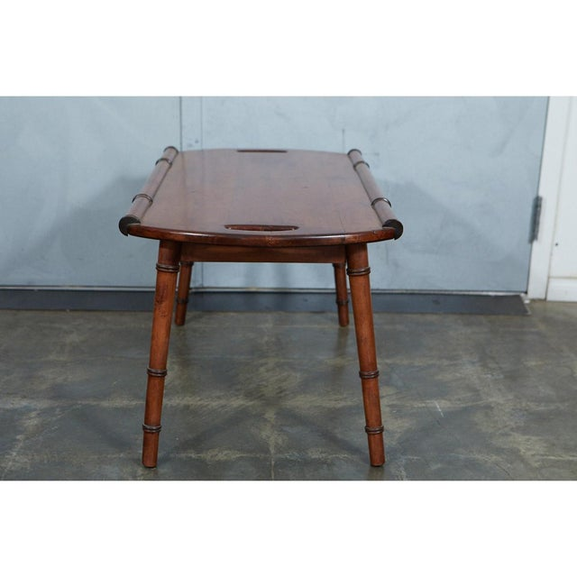 This mid-century faux bamboo tray top coffee table has a wonderful look. The turned, splayed legs have faux bamboo details...
