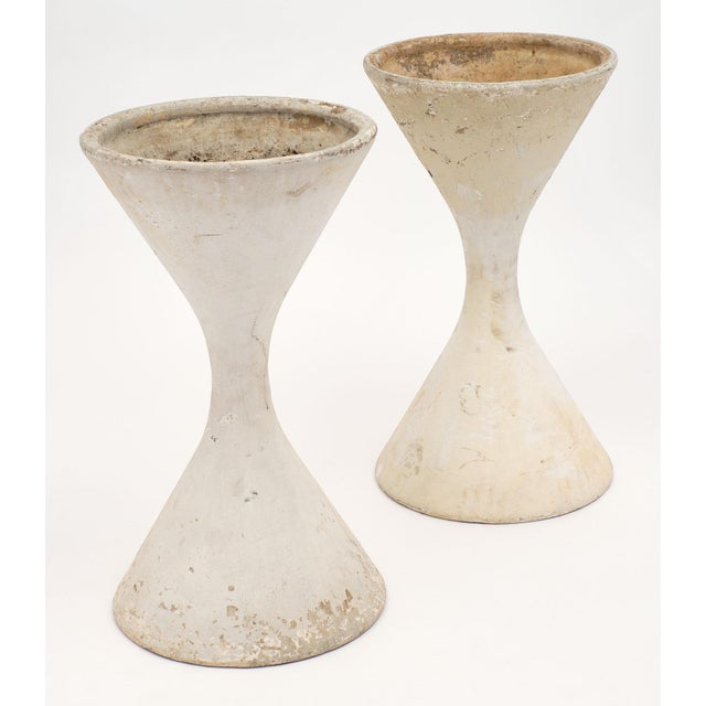 Iconic pair of mid-century jardinières by Willy Guhl, each in the shape of an hour glass. They are in great shape with no...