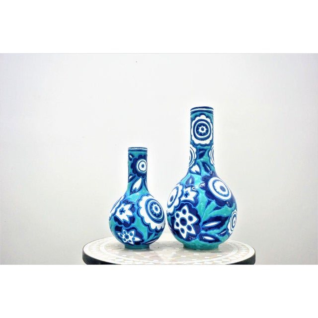 Made in Italy, this set of two matching style vases is crafted using the best pottery techniques of southern Italy. Bold...