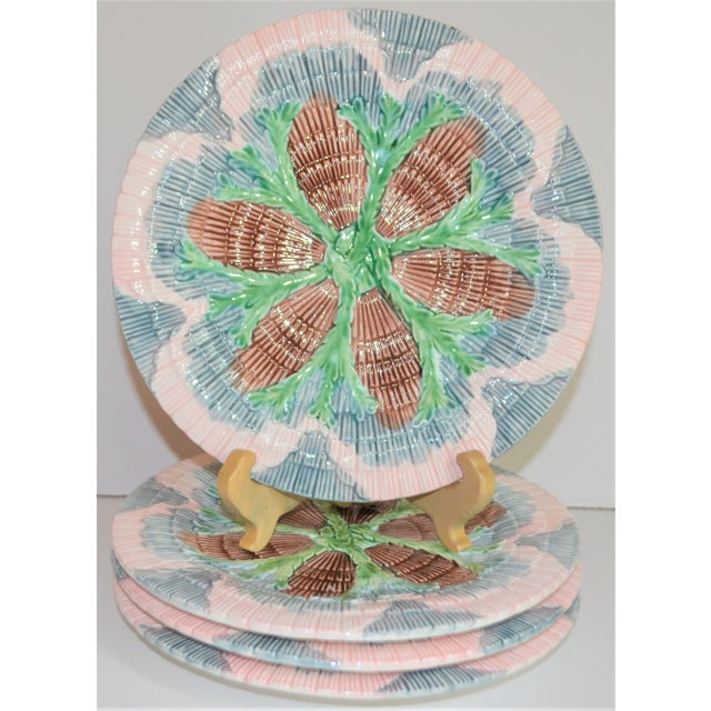 This is a vintage set of Horchow, Neiman Marcus Majolica Seaweed / Seashell plates. They are in a beautiful blush pink,...