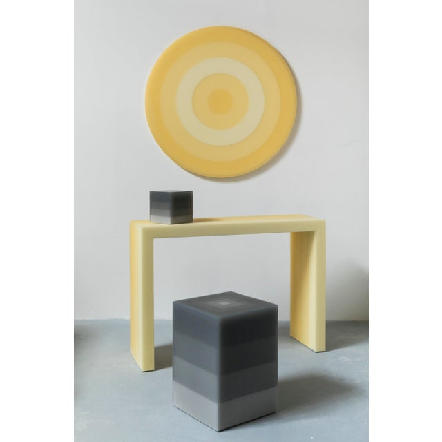This side table uses Facture Studio's Scale style to transition in four layers from a light to dark gray over a stepped...