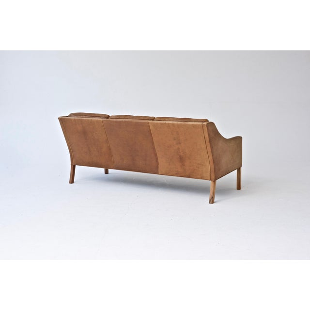 Original three-seat model 2209 sofa designed by Borge Mogensen in 1965 for Fredericia, Denmark. In original condition with...