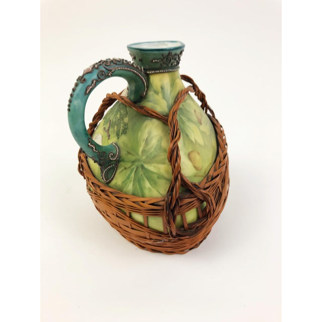 This captivating three-sided Nippon ewer features a raised design of acorns and branches against a flat green leafy...