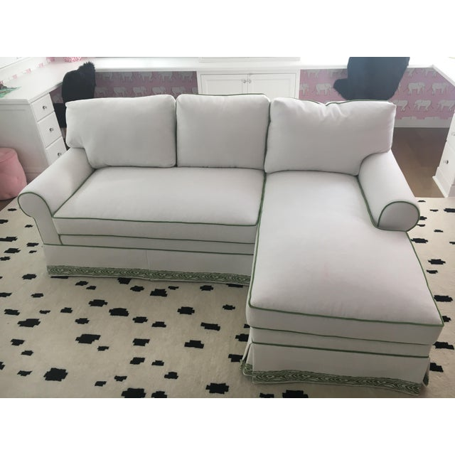 This sectional is beautiful and brand new! We had a local upholstery shop make it with one of their furniture vendors...