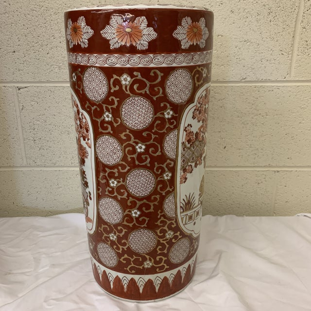 Based on the size and weight of this piece I think it's an umbrella stand, but could certainly be used as a vase....