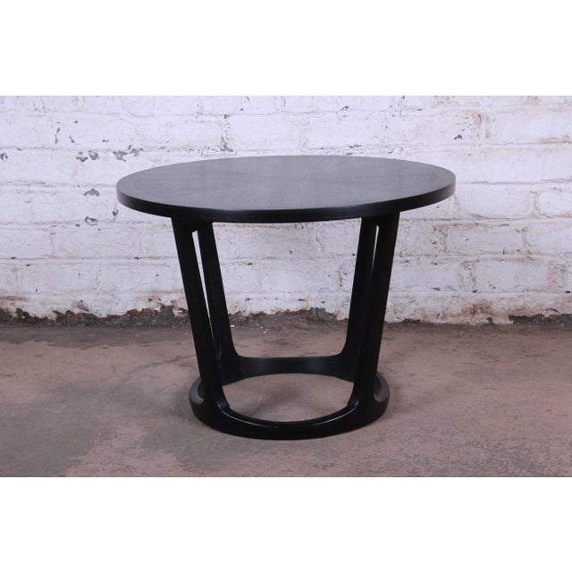 Offering a very nice Lane ebonized sculpted walnut round side table. The table has recently been refinished and has a nice...