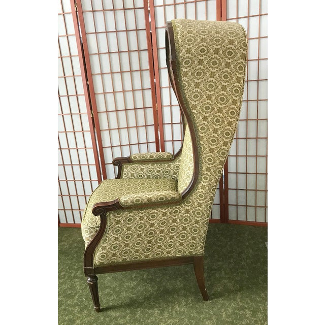 Very rare and very unique Hooded Bonnet Chair. Fabulous wood Trim. Upholstered in a Tapestry fabric. Upholstery is in...
