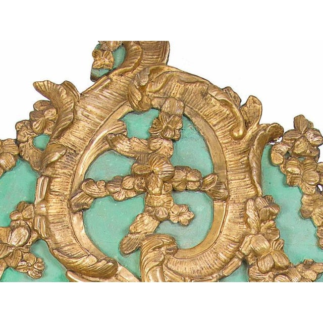 Exquisite and elaborately carved 18th century green painted and gilded wall mirror. Painted accents and gilded Rococo...