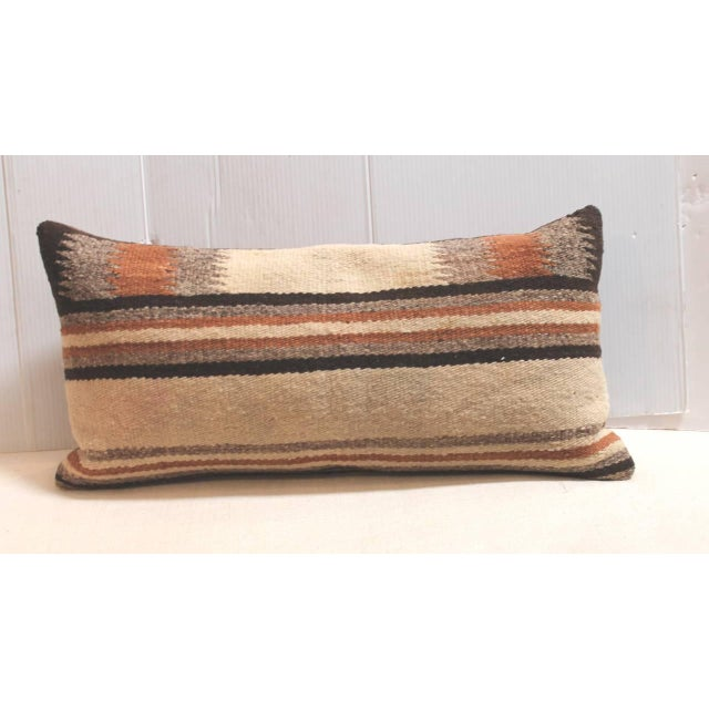 This handsome pair of Navajo Indian weaving saddle blanket pillows are in great condition and have brown cotton linen...