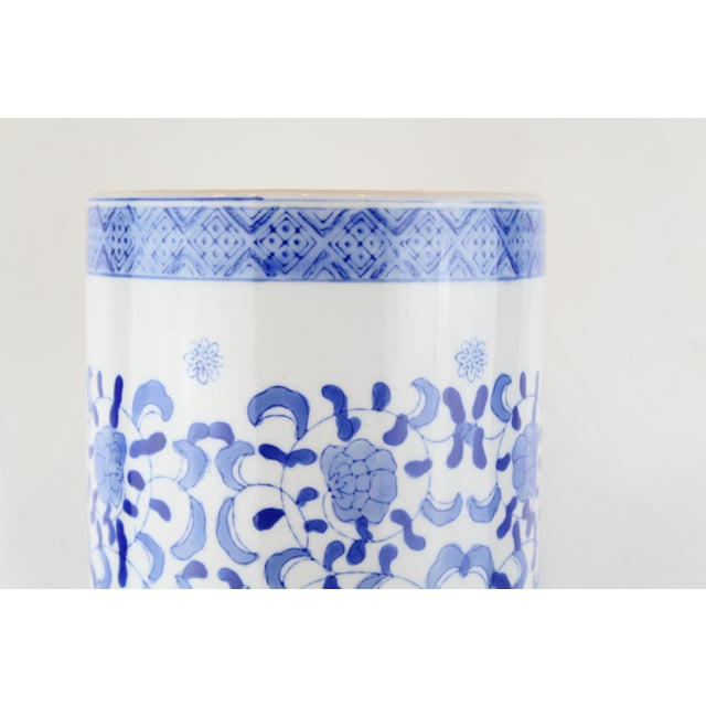 Blue and white oversize porcelain Chinese urn with floral pattern. Circa mid 20th century.