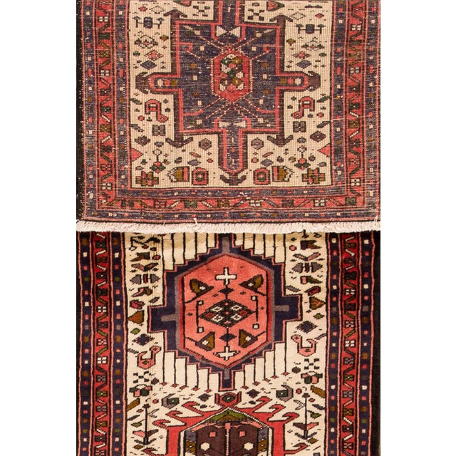 Hand-knotted Persian Heriz rug with a geometric design. This piece has great detailing and great colors. It would be the...
