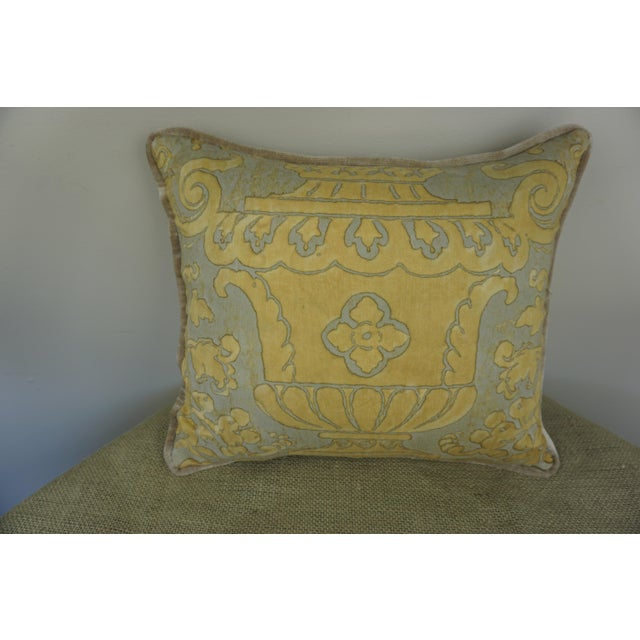 An elegant single accent pillow made from a vintage printed Fortuny cotton front in a golden wheat coloration and a cream...