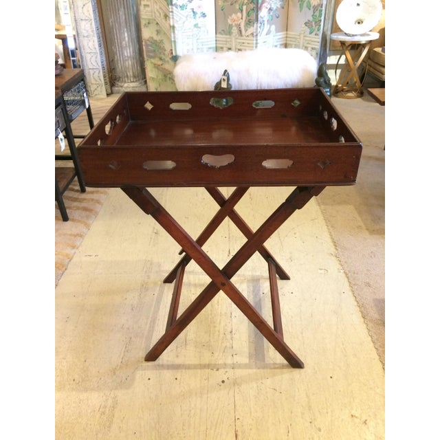 Great looking and versatile mahogany butler's tray table having a removeable tray top with cut out handles, and a foldable...