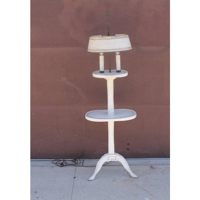 This is quite a unique floor lamp with white painted wood and gold trim. The tin shade is in a painted white and gold...