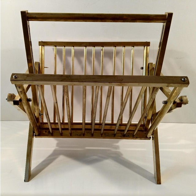 This is a very cool Mid-Century folding brass magazine rack, in the style of Mastercraft. The rack is beautifully...