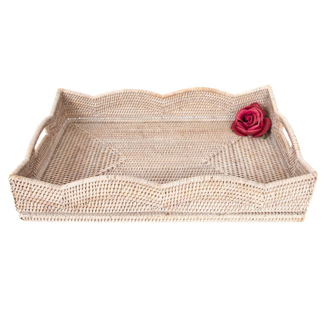 Artifacts Trading Company created the Scallop Collection of hand woven trays and baskets to provide the perfect accent to...
