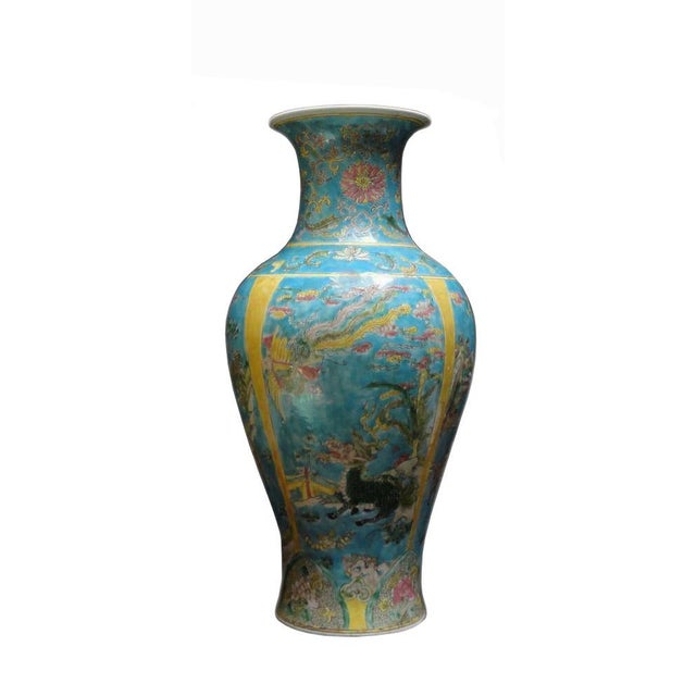 This Chinese decorative blue yellow base porcelain vase has hand painted color graphic of phoenix , Kirin, animals scenery...