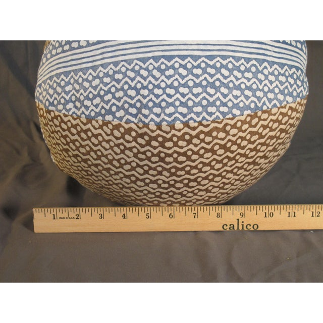 """A round pillow made from Fortuny's iconic hand printed cotton in the Tapa pattern. With a down insert, measures 36"""" around..."""