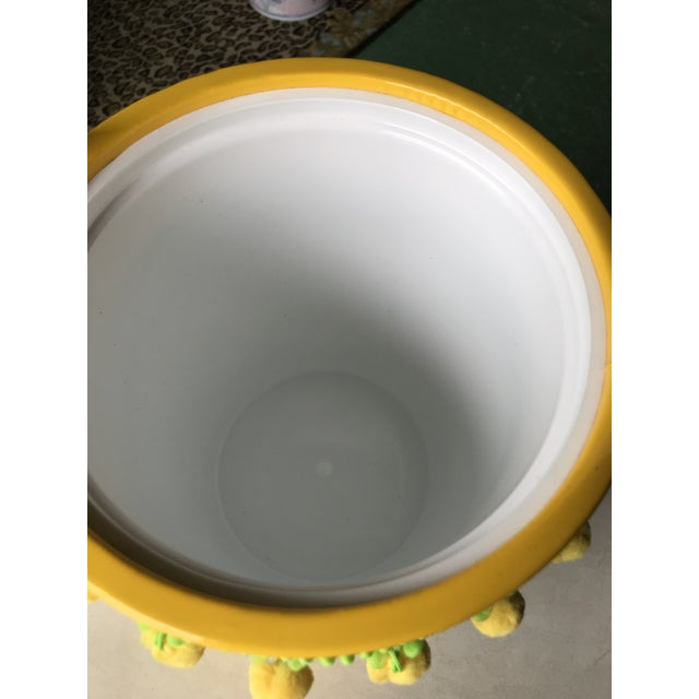 I am thinking it just doesn't get any cuter than this bright yellow MCM ice bucket with green and yellow Pom Pom fringe....